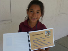 picture of one student holding her published book