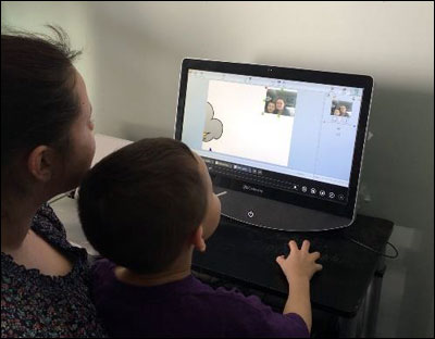 image of parent and child exploring Wixie project at home