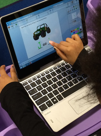 student working in Wixie at phonics station
